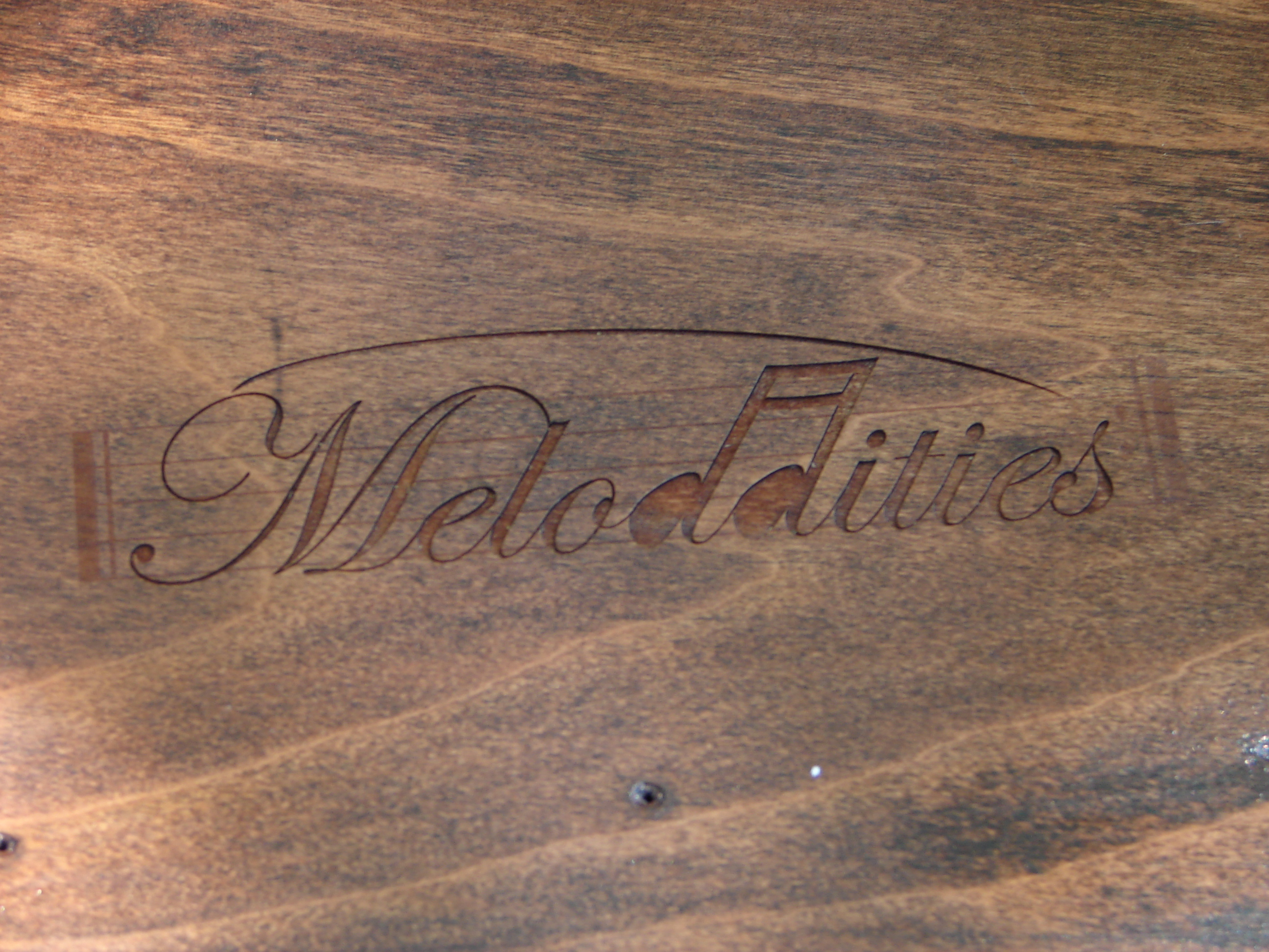 Laser Engraved Meloddities Logo