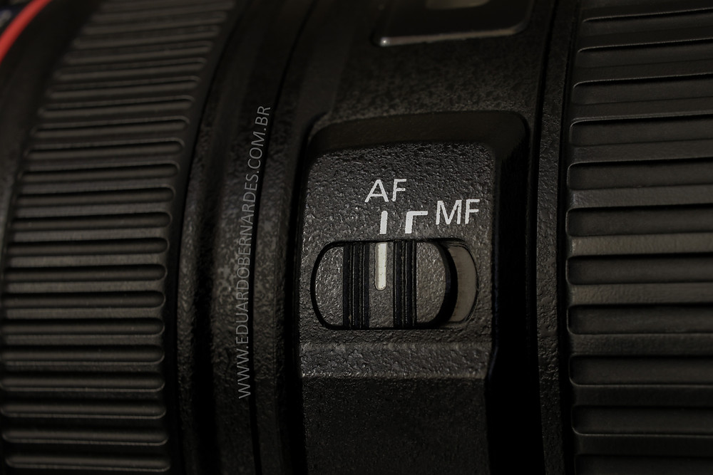 Botão de seleção do modo de focagem.