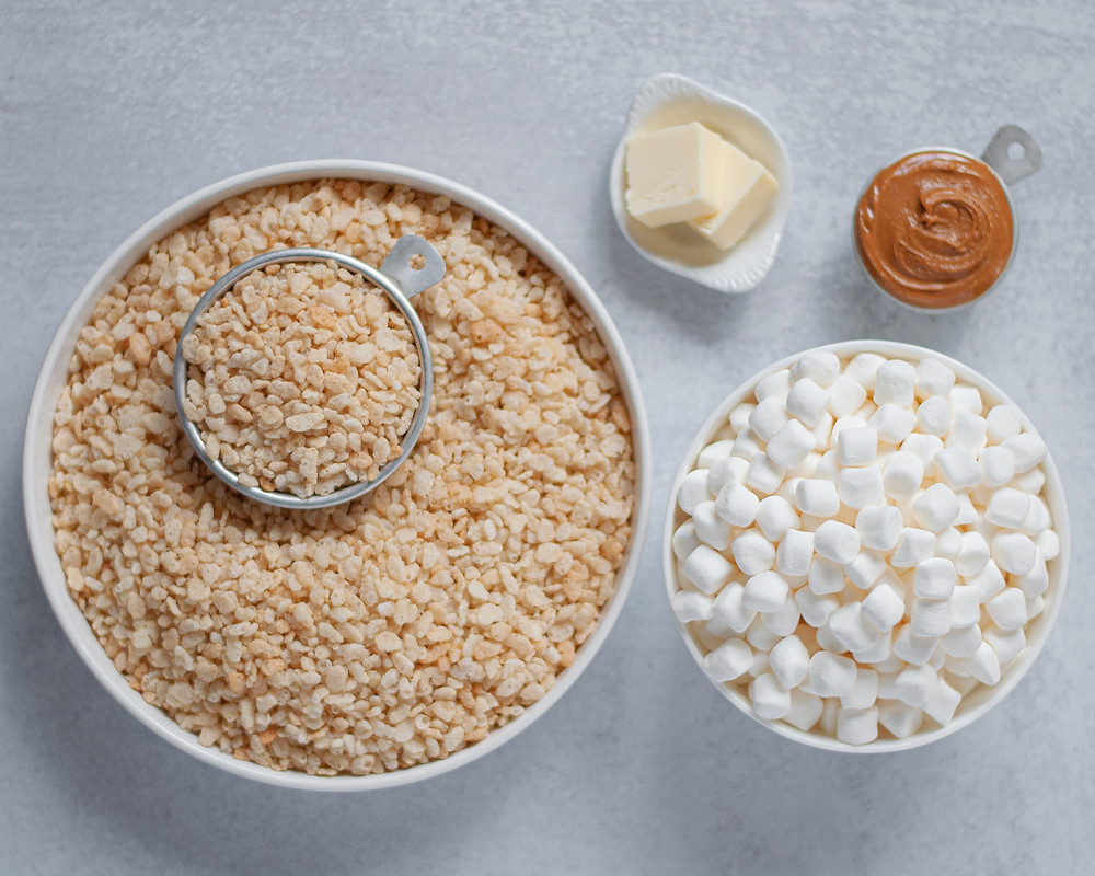 Ingredients needed to make peanut butter rice krispy treats. Rice krisy cereal, marshmallows, butter, and creamy peanut butter.