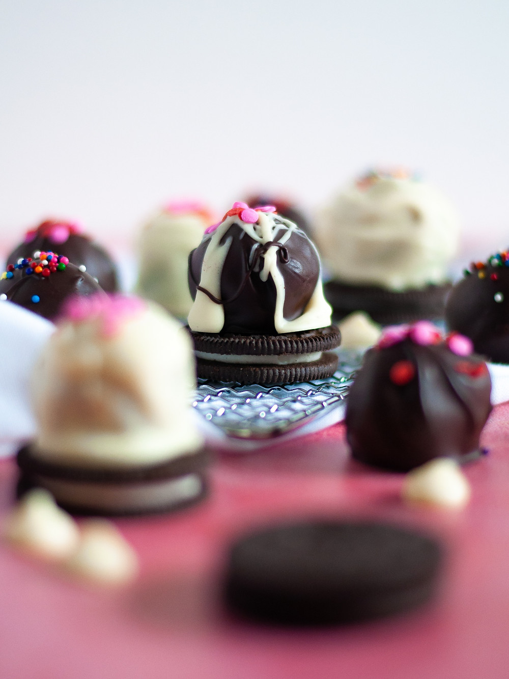 Another close up of oreo balls, displayed with oreos and chocolate chips