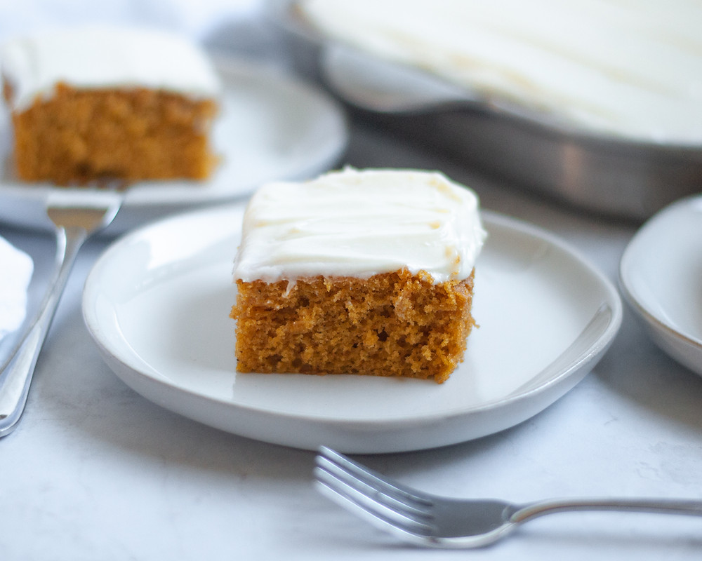 A couple of pumpkin squares served on plates and ready to eat
