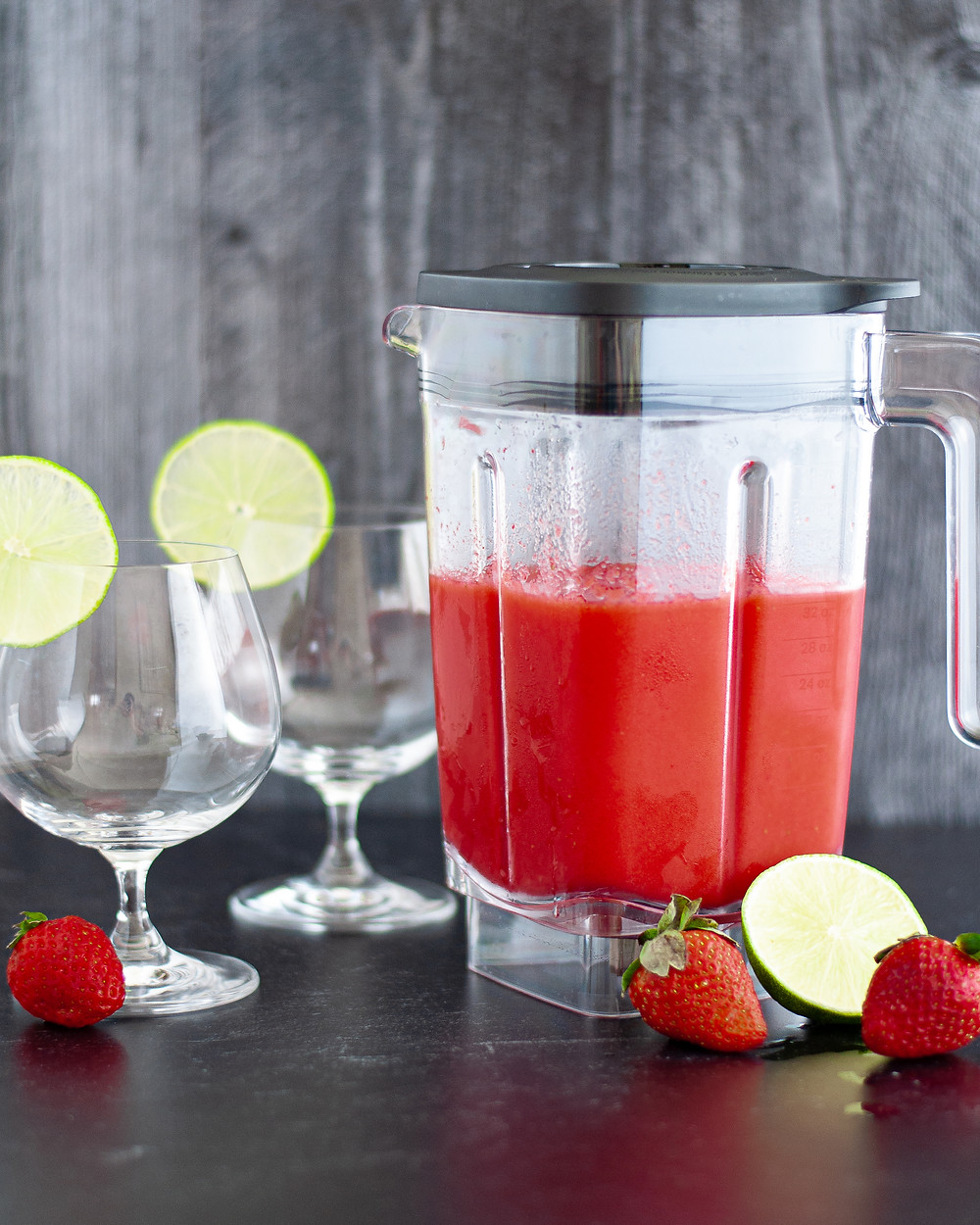 Process shot of this strawberry daiquiri being made; the frozen daiquiri is still in the blender ready to be served