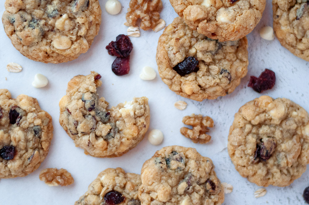 Another top down view of this oatmeal cookie recipe, with the center oatmeal craisin cookie having a bite out of it