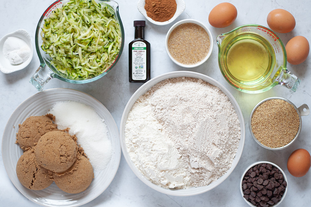 Top down view showing all ingredients needed for this whole wheat zucchini bread recipe.