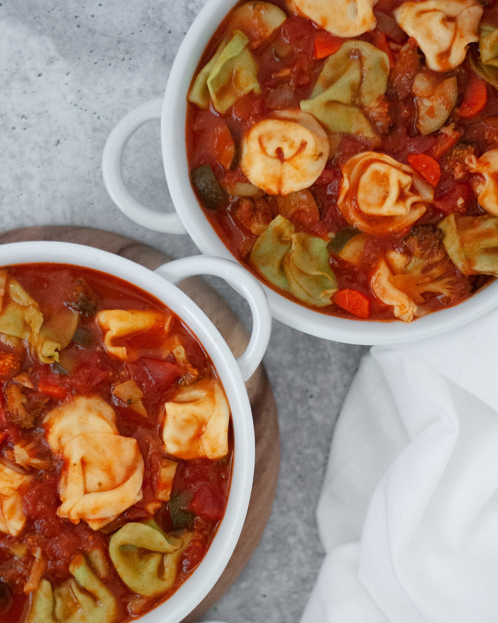 Top down view of two bowls of this tortellini soup