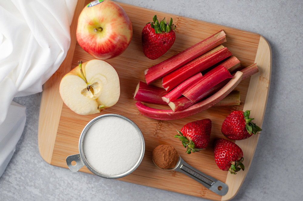 Ingredients for this rhubarb compote recipe on a cutting board.