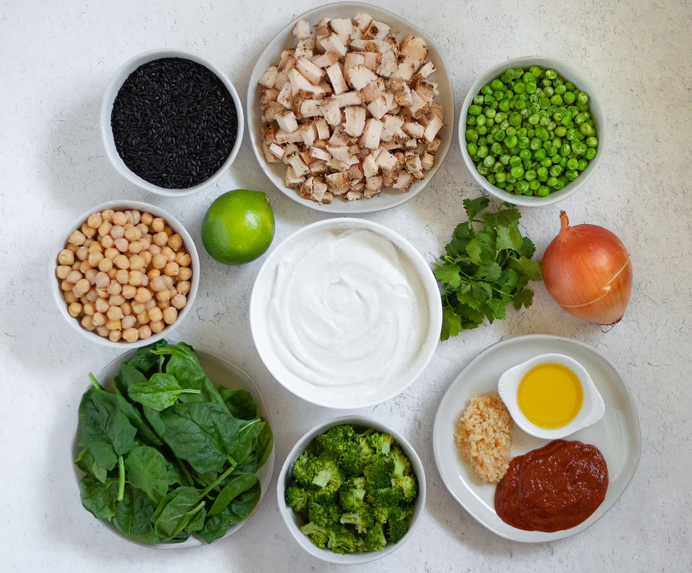 Top down ingredient shot for this chicken curry with chickpeas.