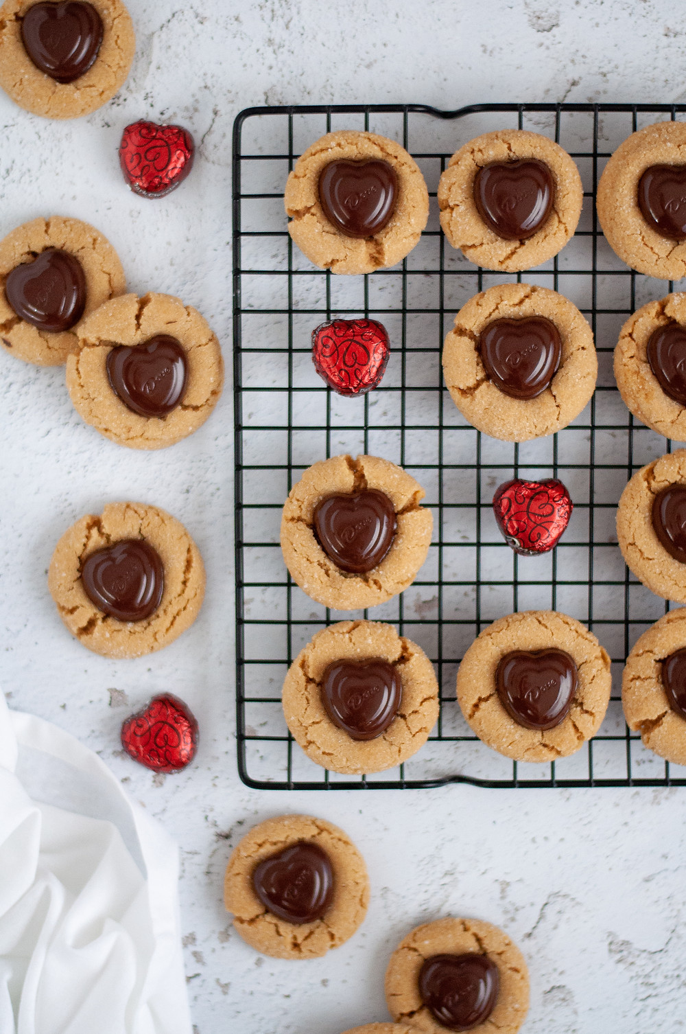 Another top down view of these peanut butter hershey kiss cookies both on and off of the wire cooling rack