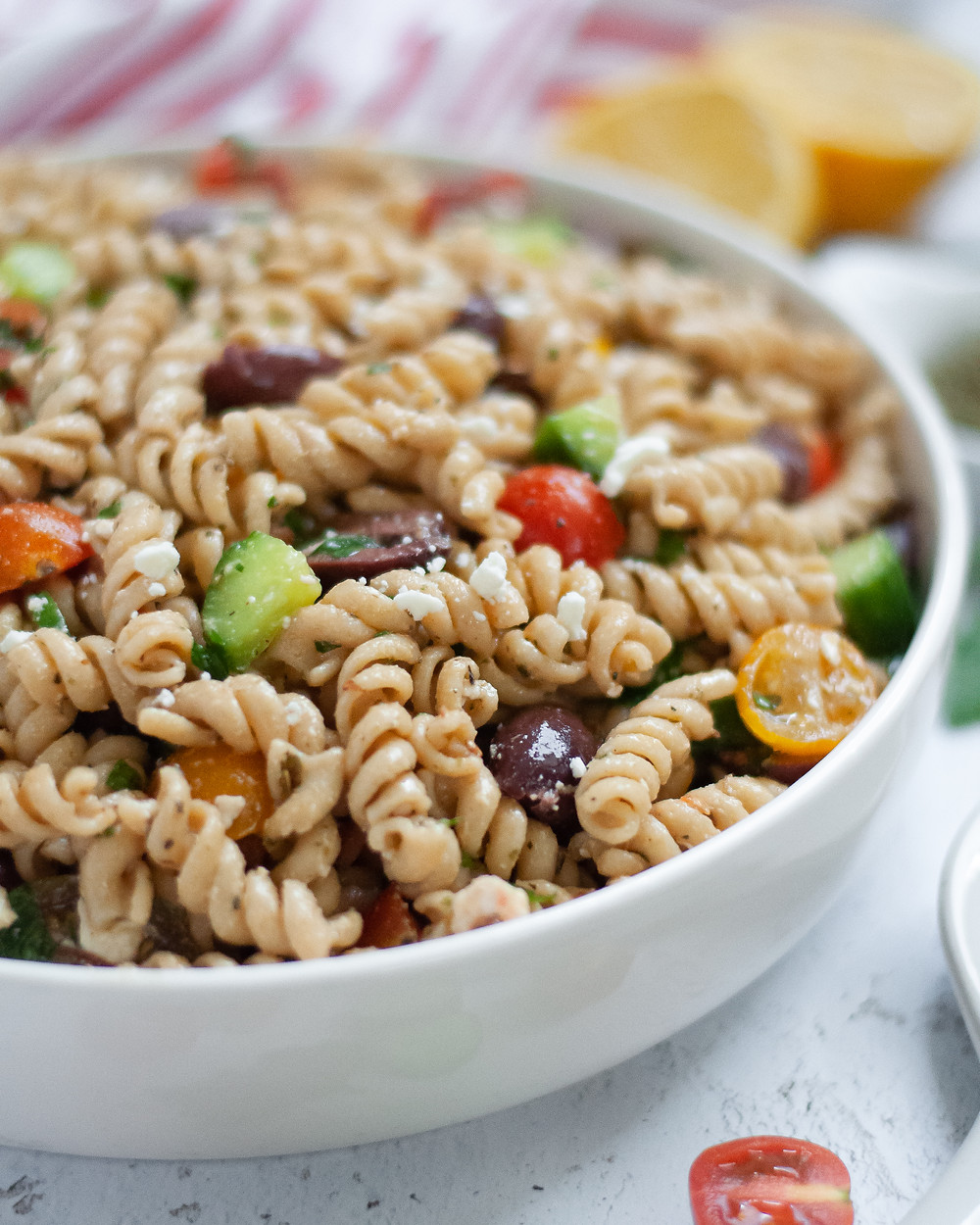 Close up of a serving bowl filled with pasta salad