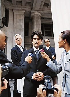 An image of a trial attorney giving an impromptu press conference after court.