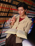 A female attorney in th law library.