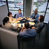 An image of clients meeting with their consulting team.