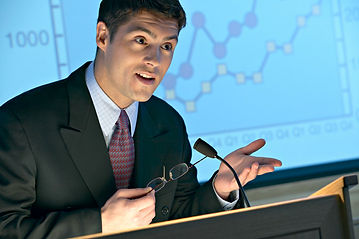 Image of a skilled speaker at the podium.