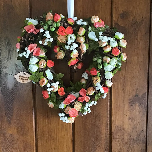 we hand make this peach and cream summer romance front door wreath in wales