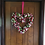 enjoy this large loving gift of a heart shaped rummer romance front door decor wreath made by making an entrance