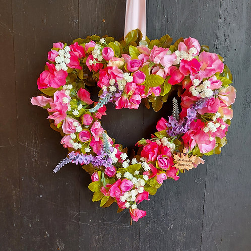 hand made in our welsh studio, this pink sweet pea front door wreath makes an ideal gift for her