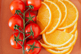 tomatoes-and-slices-of-lemon-on-table-40