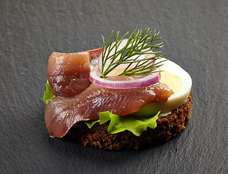 canape-with-anchovy-and-egg-on-dark-back