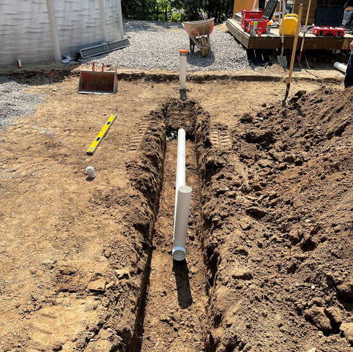 Installation of complete drainage system under patio to direct water away from the foundation