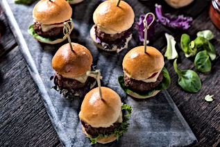 homemade  beef burgers with cheese on se
