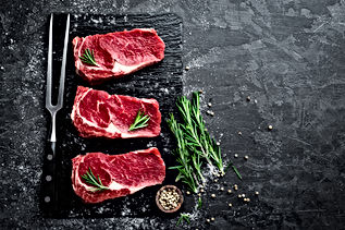 Raw meat, beef steak on black background