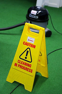 Cleaning in Progress sign with Hoover in the background