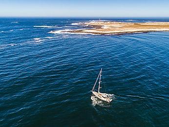 Kraken 66 ft sailing towards an island