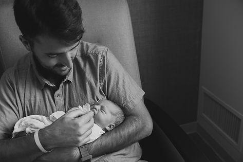 Dad holding his newborn son