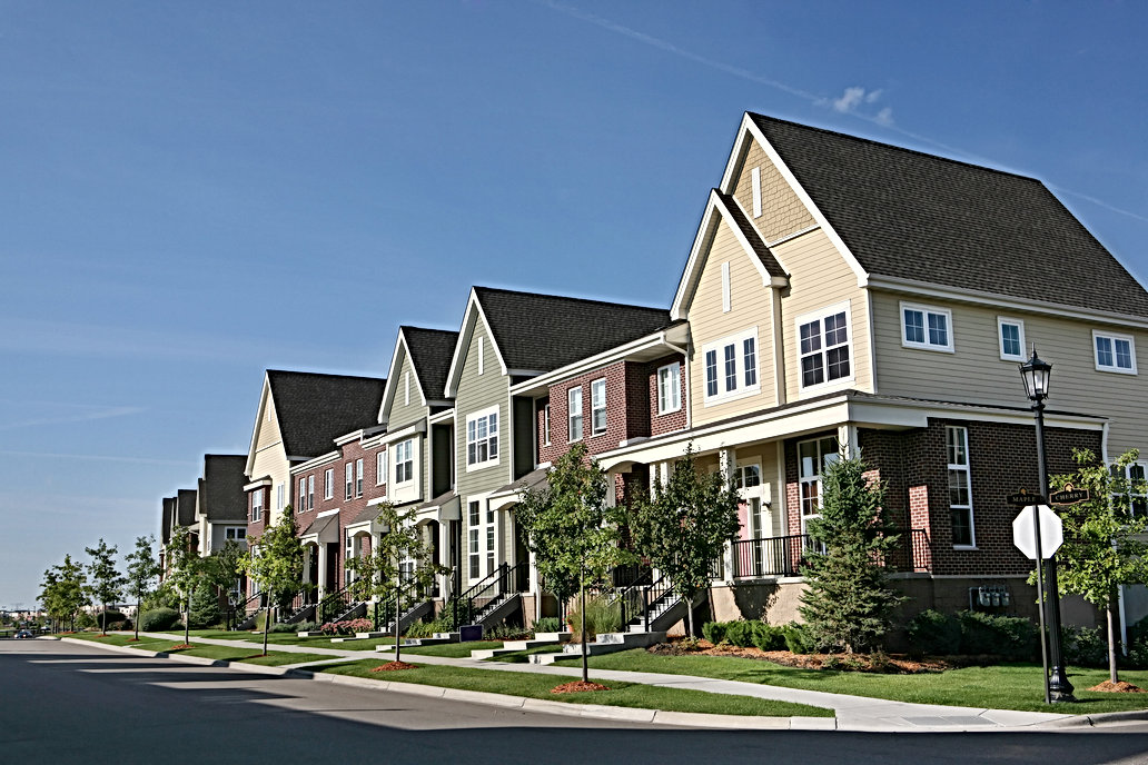 Row-of-Suburban-Townhouses-on-Summer-Day