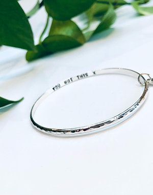 Hammered bangle with chunky heart charm
