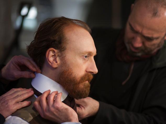 Director DavidBickerstaff helps Jamie de Courcey into costume    © Seventh Art Productions & Annelies van der Vegt