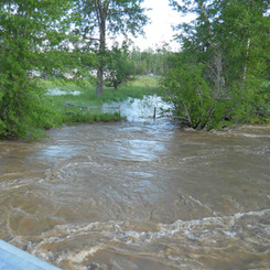 The flooding breaches the banks in the area planned to house campsites #17-21.