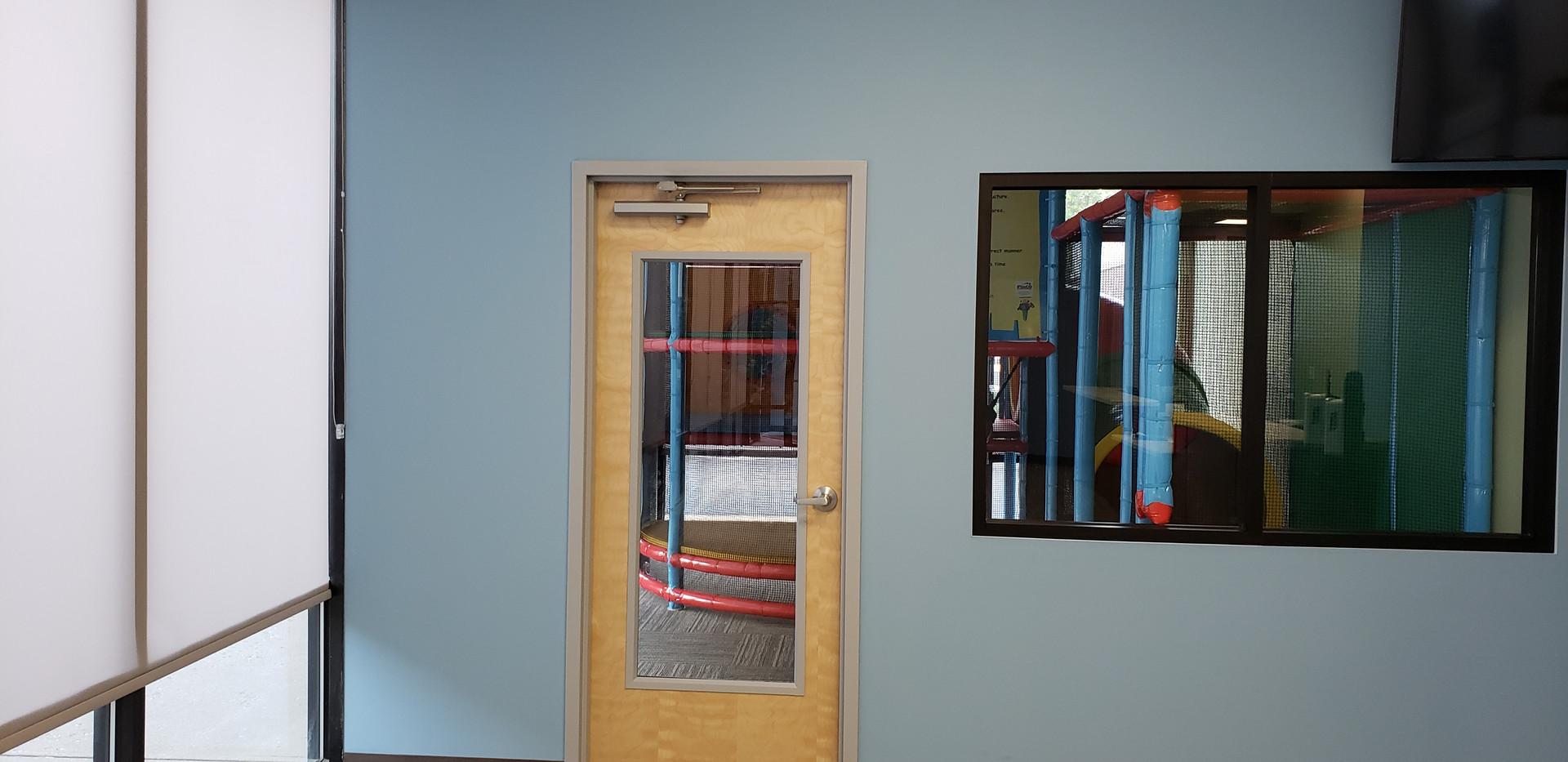 Room w/ Door & Large Windows - Buildout Pros