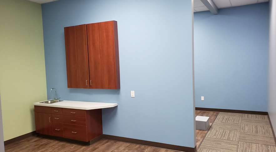 Hallway End to Dental Rooms - Buildout Pros