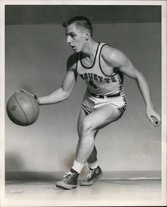 Gene Berce Drippling A Basketball