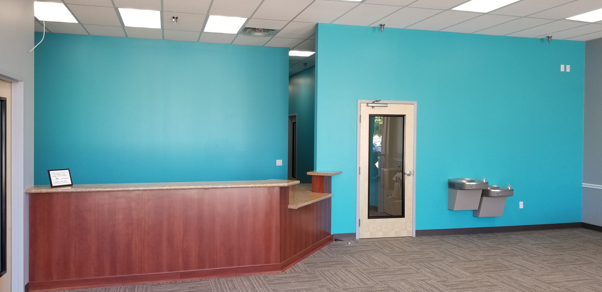 Waiting Area with View of Receiption - Buildout Pros
