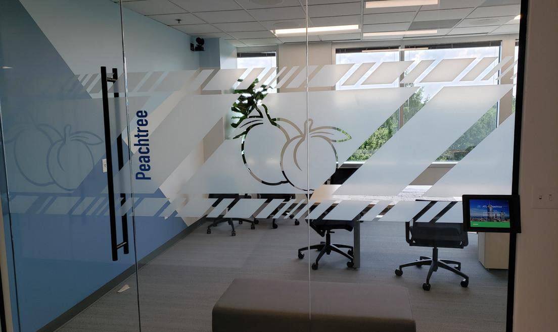 Glass Logo Meeting Room Door - Buildout Pros