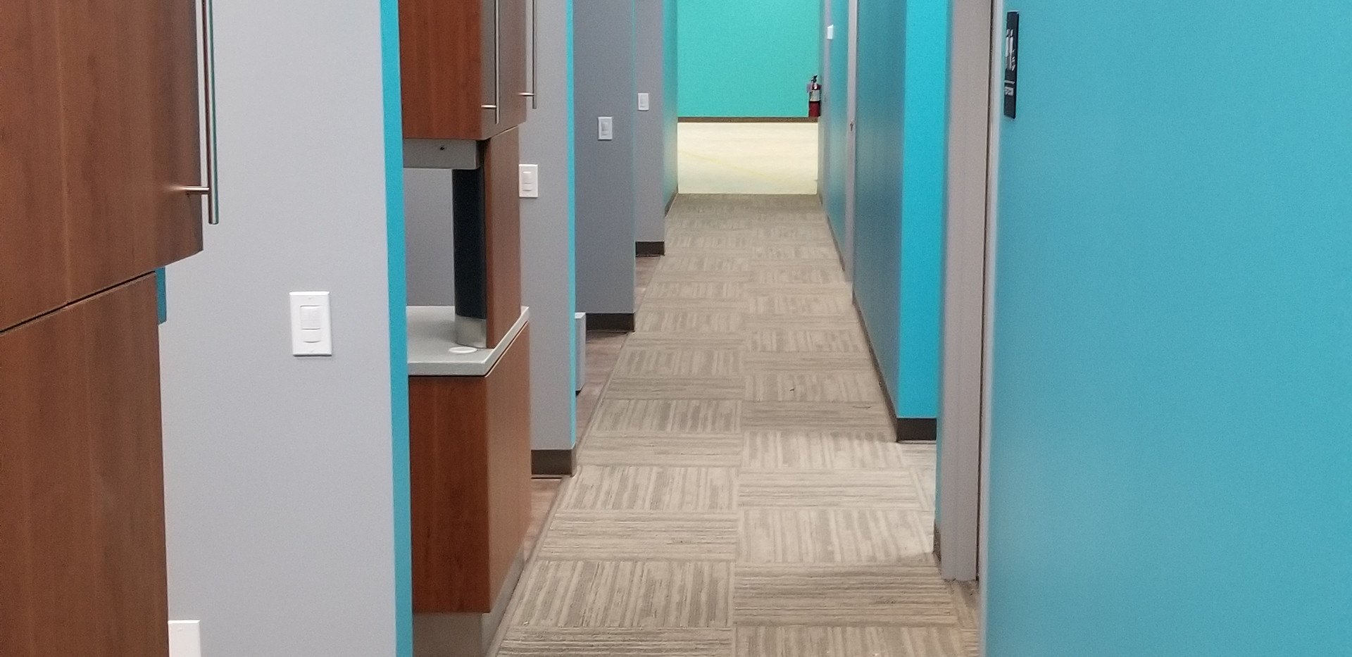 Hallway that Leds to Dental Rooms - Buildout Pros