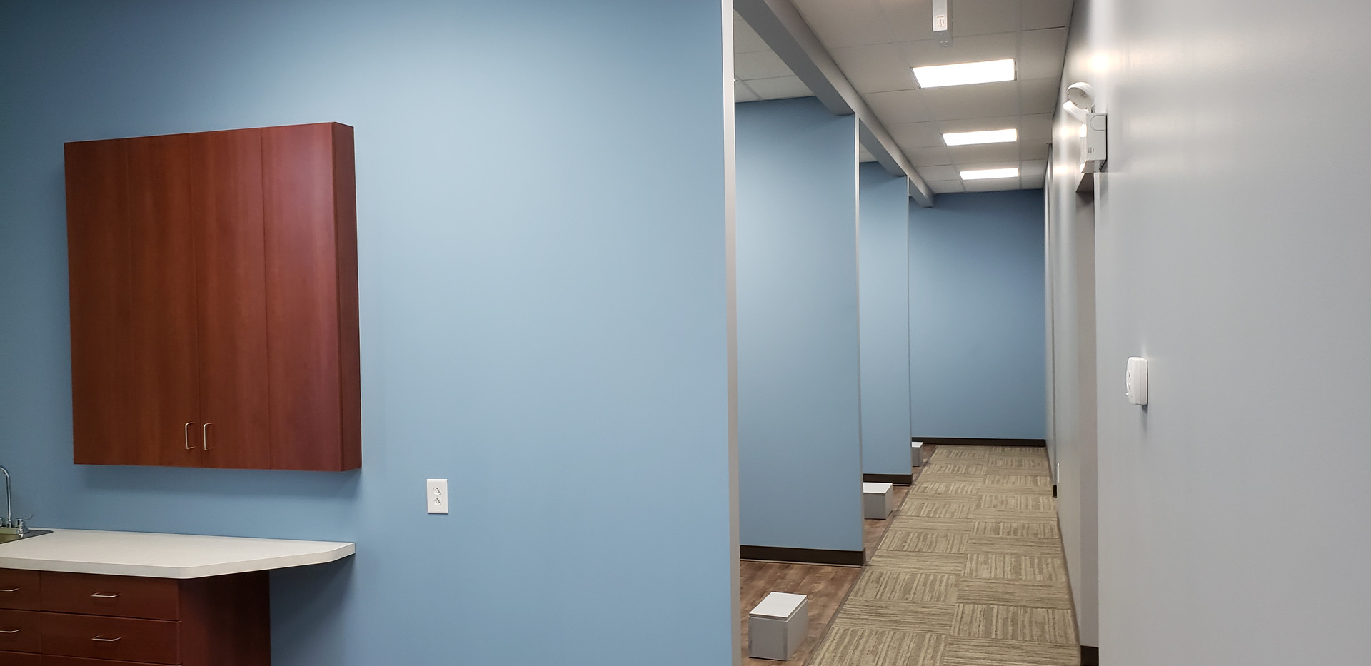 Hallway View of Dental Rooms - Buildout Pros