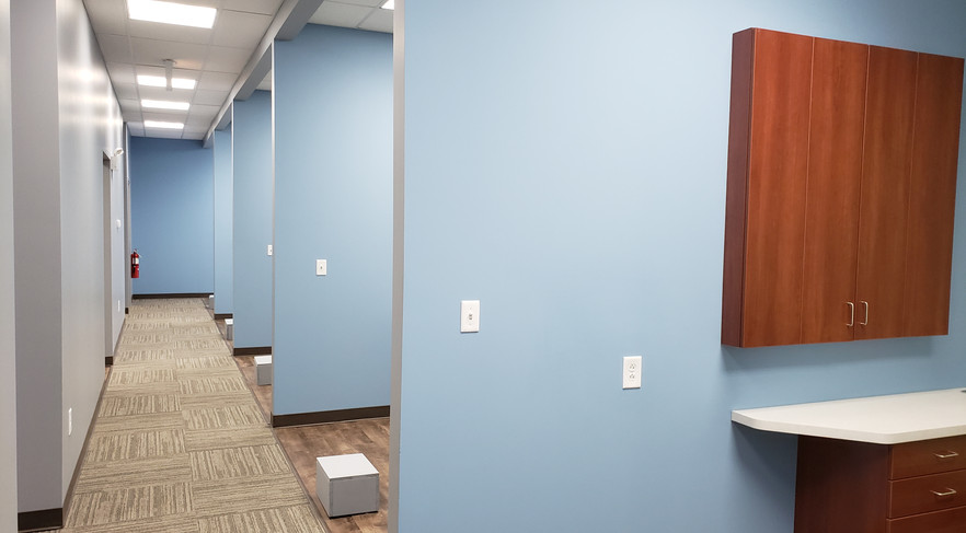View of Multiple Dental Room Dividers - Buildout Pros