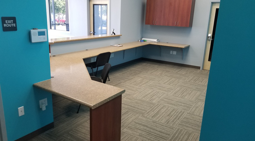 Hallway View of Receiptionist Area - Buildout Pros
