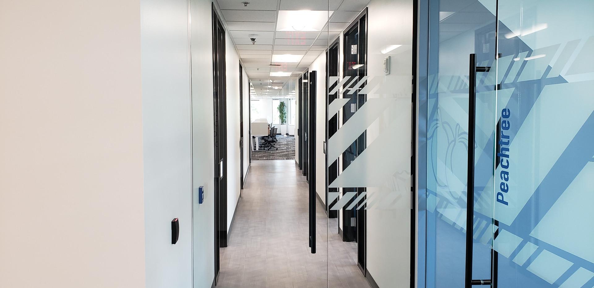 Glass Door Office Hallway - Buildout Pro