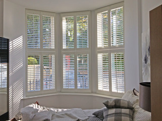 Tier On Tier Shutters From Plymouth Shutters And Blinds