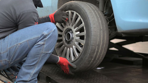 man-changing-a-car-tire-3806249_edited_e