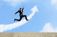 happy successful business man jump and run with arrow cloud and blue sky background, asian male