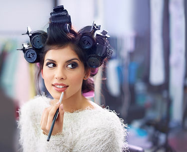 Makeup girl with curlers.jpg