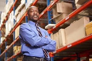 Portrait Of Businessman In Warehouse.jpg