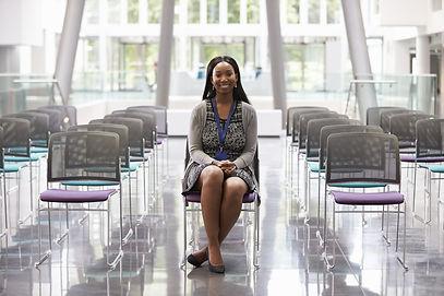 Businesswoman In Empty Auditorium Prepar