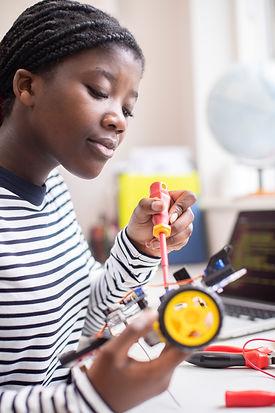 Female Teenage Pupil Building Robot Car