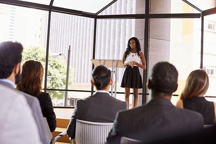 Young black businesswoman presenting sem
